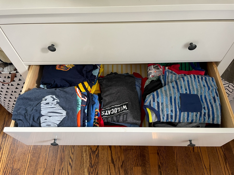 short and long sleeve shirts in a drawer