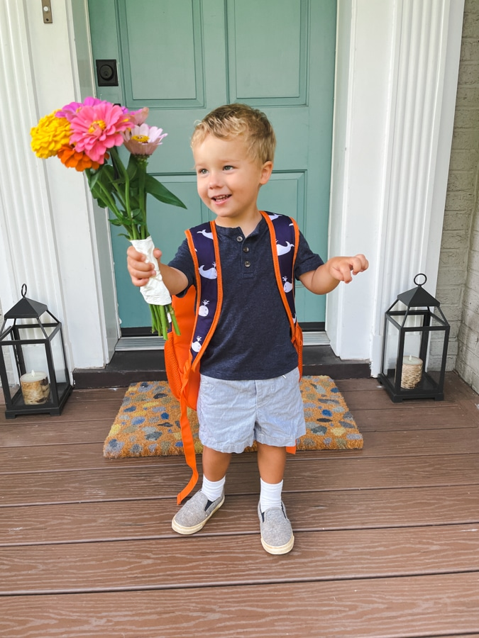 Boy holding floor on first day of school