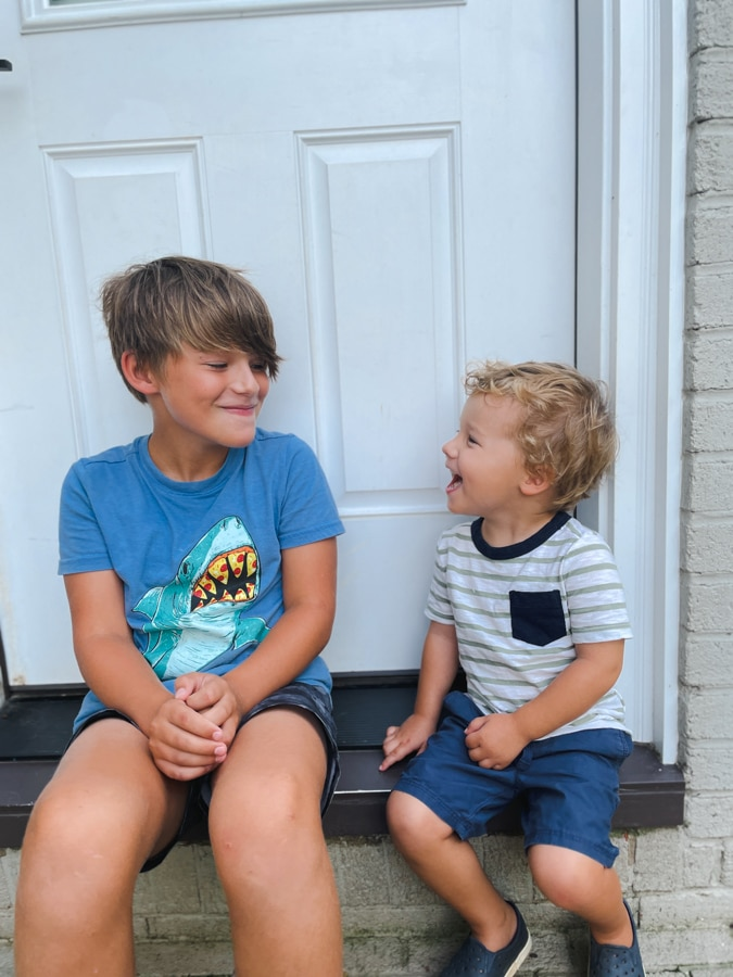 boy in shark shirt and boy in striped t shirt