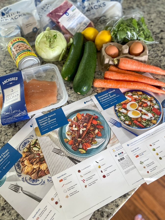wellness by blue apron recipes and ingredients laid out on a countertop