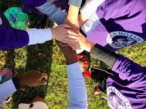 fall sports hands in the middle